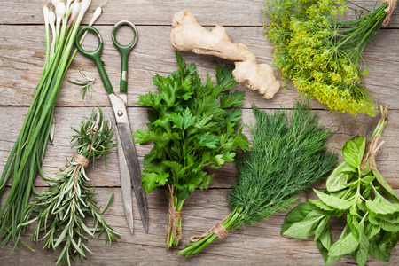 herbs white background: Fresh garden herbs on wooden table. Top view Stock Photo