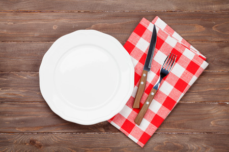 Empty plate and silverware over wooden table background. View from above with copy space Stock fotó