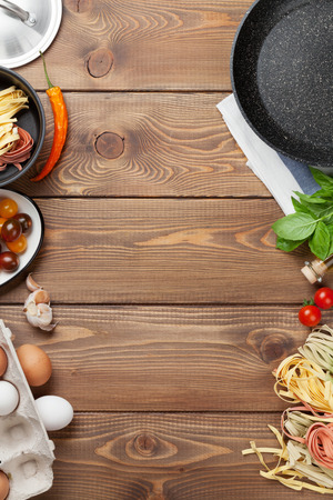 recipe: Pasta cooking ingredients and utensils on wooden table. Top view with copy space Stock Photo