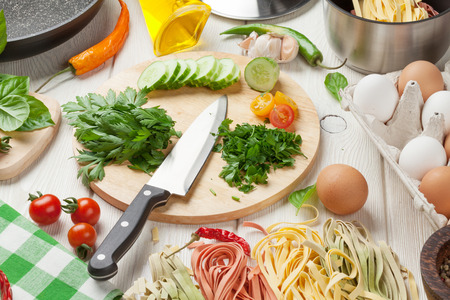 kitchen  cooking: Pasta cooking ingredients and utensils on wooden table