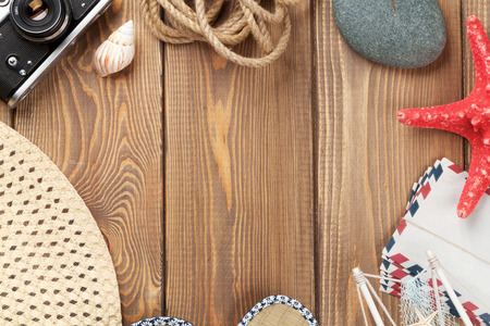 Travel and vacation background with items over wooden table. Top view with copy space Archivio Fotografico