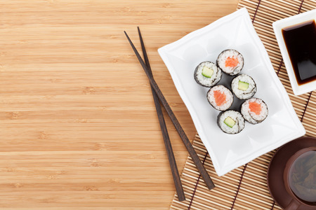raw tea: Sushi set, chopsticks and soy sauce over bamboo table with copy space Stock Photo
