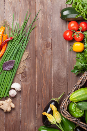produces: Fresh farmers garden vegetables on wooden table. Top view with copy space