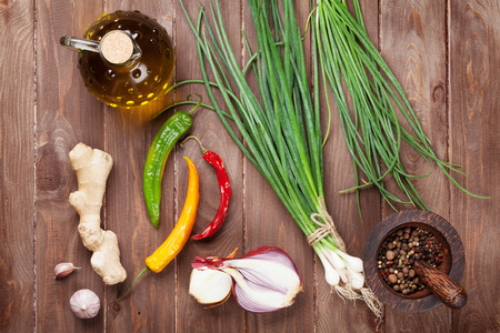 seasoning: Fresh garden herbs and spices on wooden table. Top view