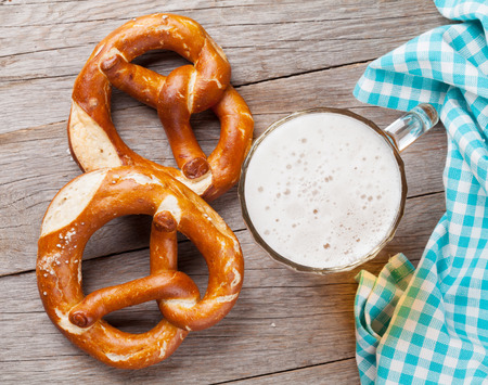 bier festival: Beer mug and pretzel on wooden table. Top view