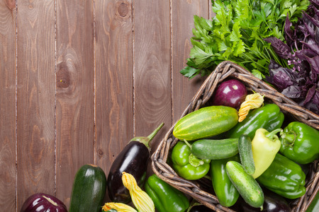 fruit market: Fresh farmers garden vegetables on wooden table. Top view with copy space