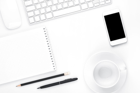 computer message: Office desk table with computer, supplies and coffee cup. Top view with copy space Stock Photo