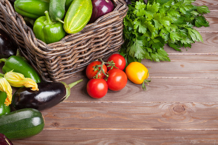 Fresh farmers garden vegetables and herbs on wooden table. View with copy space Stock Photo