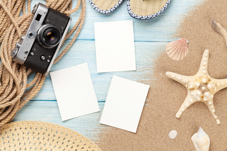 photo: Travel and vacation photo frames and items on wooden table. Top view Stock Photo