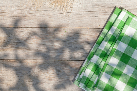 background summer: Empty wooden garden table with tablecloth. Top view with copy space