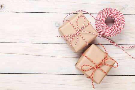 scene: Gift wrapping over white wooden table with copy space