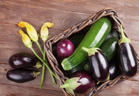 fruits in a basket: Fresh farmers garden vegetables on wooden table. Top view