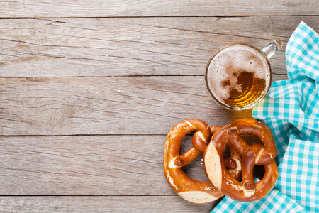 bier festival: Beer mug and pretzel on wooden table. Top view with copy space Stock Photo