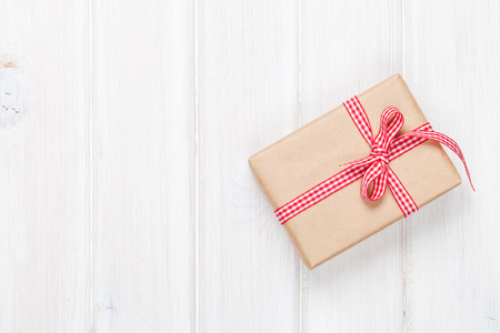 Gift box on wooden table background with copy space