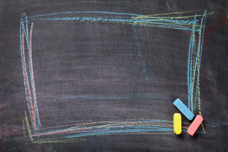 Colorful chalk frame on blackboard background. Top view with copy space