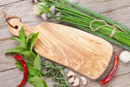 flavours: Fresh herbs and spices on wooden table. Top view with copy space