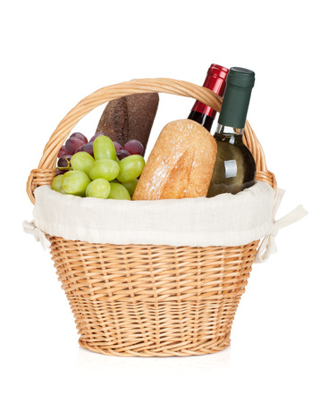 wine grape: Picnic basket with bread, cheese, grape and wine bottles. Isolated on white background