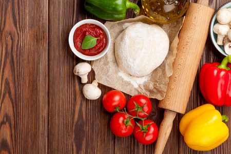 homemade: Pizza cooking ingredients. Dough, vegetables and spices. Top view with copy space Stock Photo