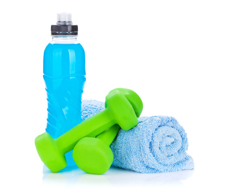 Two green dumbells, towel and water bottle. Fitness and health. Isolated on white background