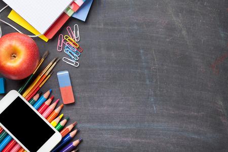黒板背景に学校・事務用品コピー スペース平面図 写真素材