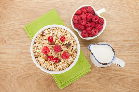 healthy breakfast: Healty breakfast with muesli, berries and milk on wooden table