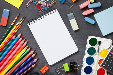 School and office supplies on blackboard background. Top view with copy space Stok Fotoğraf - 44273567