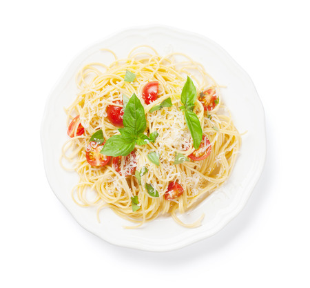 spaghetti dinner: Spaghetti pasta with tomatoes and basil. Isolated on white background Stock Photo