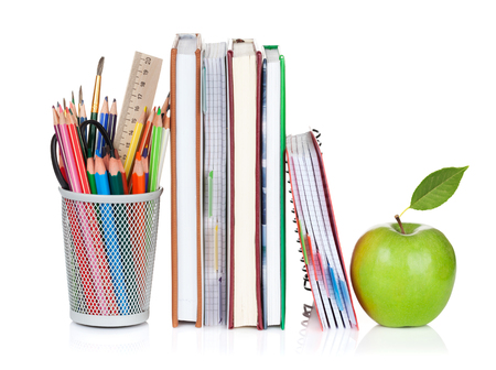 School and office supplies. Notepads, colorful pencils and apple. Isolated on white background