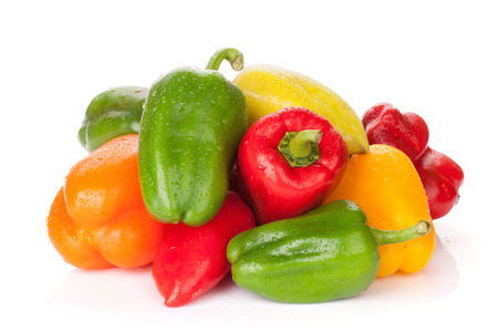Fresh colorful bell peppers. Isolated on white background