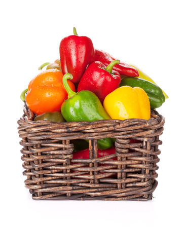 bell peppers: Fresh colorful bell peppers in box. Isolated on white background