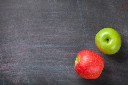 Green And Red Apples On Blackboard Or Chalkboard Background Top View With Copy Space Photo