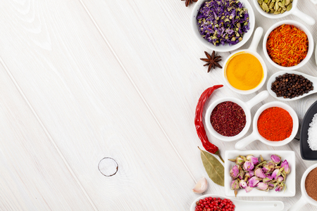 indian spice: Various spices on white wooden background. Top view with copy space