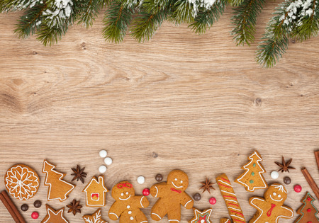 gingerbread cookies: Christmas fir tree and gingerbread cookies on wooden board Stock Photo