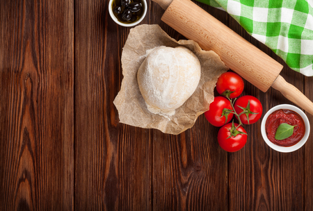 pizza ingredients: Pizza cooking ingredients. Dough, vegetables and spices. Top view with copy space Stock Photo