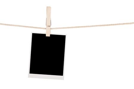 rope border: Blank photo hanging on clothesline. Isolated on white background Stock Photo