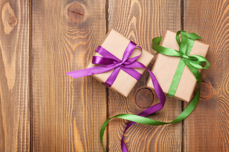purple ribbon: Gift boxes on wooden table background with copy space Stock Photo
