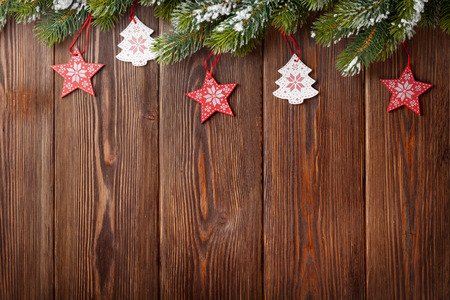 pine trees: Christmas tree with decor on wooden table. View with copy space