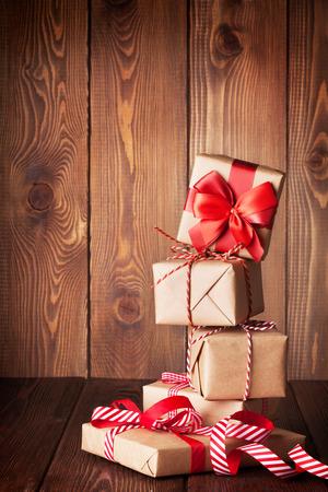 christmas gift: Christmas gift boxes on wooden table
