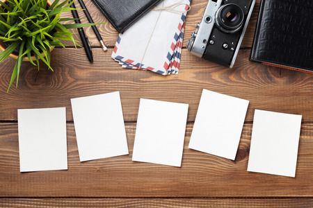blank photo: Blank photo frames, camera and supplies on wooden table. Top view Stock Photo