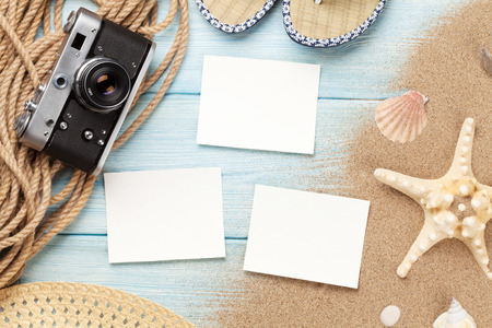 ocean background: Travel and vacation photo frames and items on wooden table. Top view Stock Photo