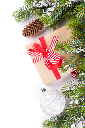 christmas isolated: Christmas tree branch and gift box. Isolated on white background