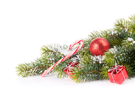 christmas tree branch: Christmas tree branch with snow and decor. Isolated on white background Stock Photo
