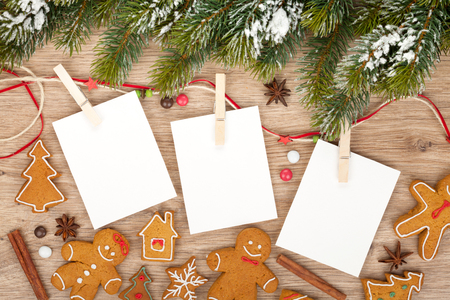 gingerbread: Blank christmas photo frames with fir tree and gingerbread cookies