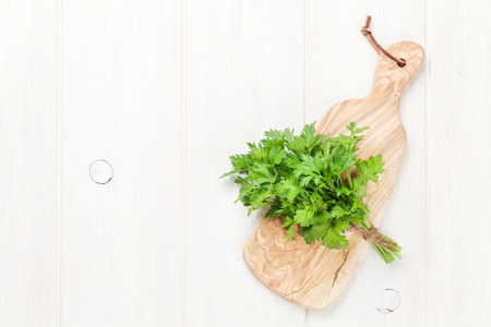 cutting board: Fresh garden parsley on cutting board. Top view with copy space Stock Photo