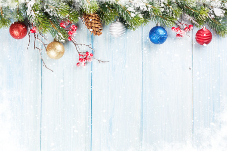 snow tree: Christmas wooden background with snow fir tree and decor. View with copy space