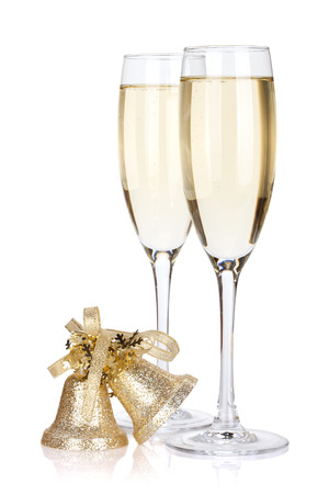champagne glasses: Two champagne glasses and bells. Isolated on white background
