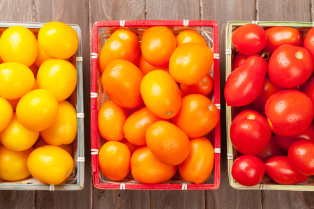 fruit market: Colorful tomatoes on wooden table. Top view