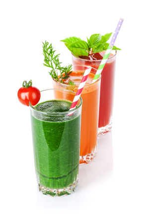 tomate: Fresh vegetable smoothie. Tomato, cucumber, carrot. Isolated on white background Banque d'images