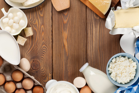 eggs: Dairy products on wooden table. Milk, cheese, egg, curd cheese and butter. Top view with copy space