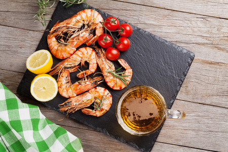 fruit plate: Grilled shrimps on stone plate and beer mug